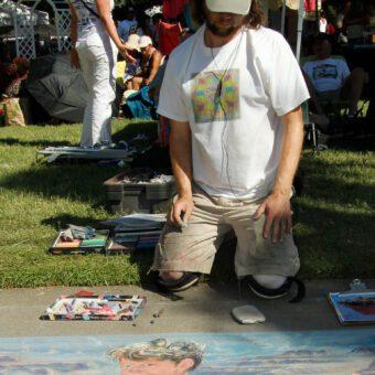 Artist Andy Huff creating his 2015 chalk art masterpiece