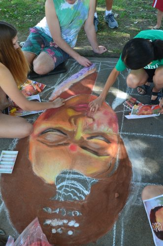 an image of kids creating chalk art