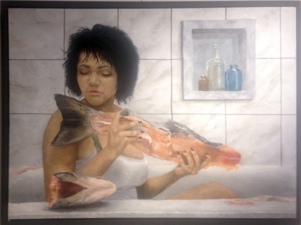 an image of woman with fish