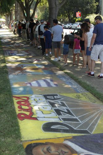 an image of people viewing chalk art